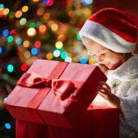 Happy little girl opening present