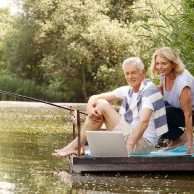 A recently retired couple enjoying their time on a dock